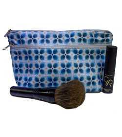 Trousse de maquillage bleue à motifs géométriques