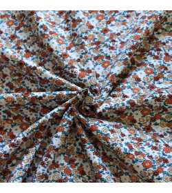 Tissu coton fleuri orange et vert